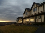 The sun sets on Howe Caverns' main building, March 15, 2012. The patio is where our ceremony will take place; the sun reflects off the windows of the room in which our reception will be held.